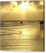 Enjoying The Beach At Sunset Canvas Print