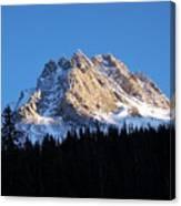Fading Afternoon Sun Illuminates Mountain Peak  Canvas Print