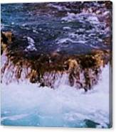 Flowing Over The Rocks Canvas Print