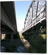 Flowing Under The Bridges Canvas Print