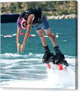 Flyboarder Bending Over To Dive Into Water Canvas Print