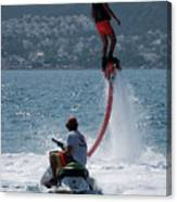 Flyboarder In Pink Shorts Above Jet Ski Canvas Print