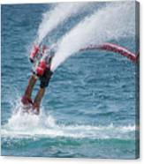 Flyboarder In Red Entering Water With Spray Canvas Print