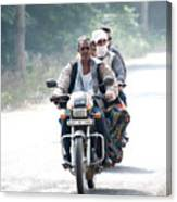 Four People On A Motorbike Canvas Print