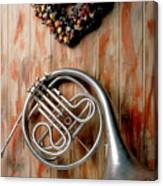 French Horn Hanging On Wall Canvas Print