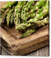Fresh Asparagus On Rustic Wooden Server Board Canvas Print