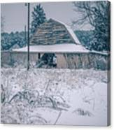 Fresh Snow Sits On The Ground Around An Old Barn Canvas Print