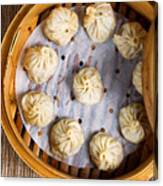 Freshly Cooked Dumplings Inside Of Bamboo Steamer Ready To Eat  Canvas Print