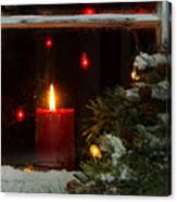 Glowing Christmas Candle In Frosted Home Window Canvas Print