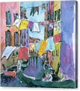 Gondola In A Venetian Canal Canvas Print