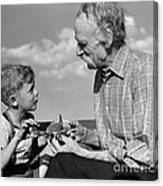 Grandfather And Boy With Model Plane Canvas Print