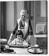 Grandmother And Granddaughter Baking Canvas Print