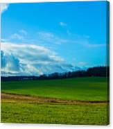 Green Grass And Blue Sky With White Clouds Canvas Print