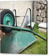 Green Wheelbarrow Lying On A Green Meadow Canvas Print