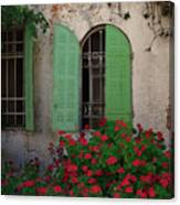 Green Windows And Red Geranium Flowers Canvas Print