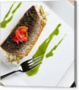 Grey Mullet With Watercress Sauce Presented On A Square White Plate With Cutlery And Napkin Canvas Print