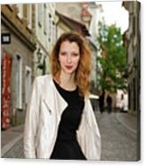 Grinning Attractive Woman Standing On Cobblestone Street Of Uppe Canvas Print