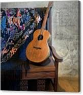 Guitar On A Bench Canvas Print