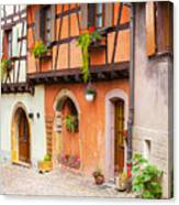 Half-timbered House Of Eguisheim, Alsace, France.  Canvas Print