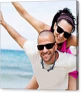 Happy Couple On Beach Canvas Print