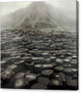 Hexagon Stones And A Mountain In The Morning Fog Canvas Print