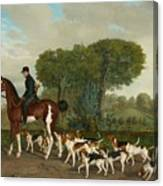 Hunter With A Pack Of Dogs Canvas Print