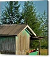 Hut With Green Boat Canvas Print