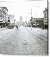 In This Historical 1913 Photo, Horse Drawn Carriages In Downtown Austin, Texas Run Up And Down Congress Avenue Cobblestone Streets Leading Up The The Texas State Capitol Canvas Print