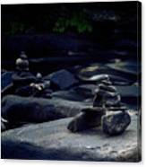 Inuksuk Stone Figures And River Canvas Print