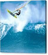 Jason Flies Over A Wave Canvas Print