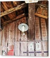 Light Hanging Inside An Old Wooden Hut Canvas Print