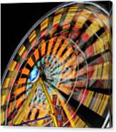 Light Streaks From The Spinning Ferris Wheel And Swing At Night  Canvas Print
