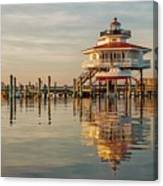 Lighthouse Glow And Reflection  Canvas Print