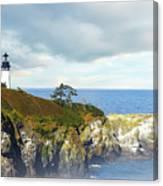Lighthouse On A Jetty. Canvas Print