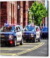 Line Of Police Cars Canvas Print