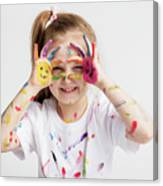 Little Girl Covered In Paint Making Funny Faces. Canvas Print
