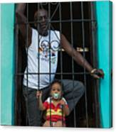 Man And Son In The Window Canvas Print