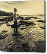 Man Gazing Out On Coastal Rocks Canvas Print