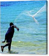 Man Launching His Fishing Net Into The Crystal Water Canvas Print