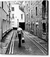 Man Walking With Shopping Bag Down Narrow English Street Canvas Print
