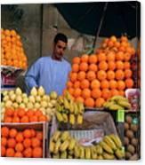 Market Vendor Selling Fruit In A Bazaar Canvas Print