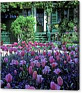 Monet's House With Tulips Canvas Print