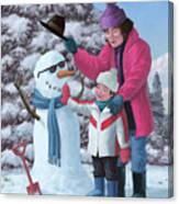 Mother And Child Building Snowman Canvas Print