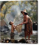 Mother And Son Are Happy With The Fish In The Natural Water Canvas Print