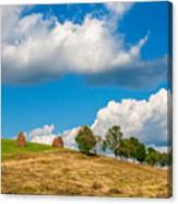 Mountain Landscape With Haystacks And Trees On Top Of Hill Canvas Print
