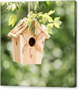 New Wooden Birdhouse Hanging On Tree Branch Outdoors  Canvas Print