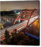 Nighttime Boats Cruise Up And Down The Loop 360 Bridge, A Boaters Paradise With Activities That Include Boating, Fishing, Swimming And Picnicking - Stock Image Canvas Print
