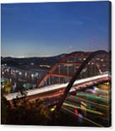 Nighttime Boats Leave Colorful Streaks As They Cruise Up And Down Lake Austin Below The 360 Pennybacker Bridge Canvas Print