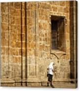 Nun Walking In Front Of Cathedral Canvas Print