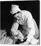 Nurse Tending To A Patient Canvas Print